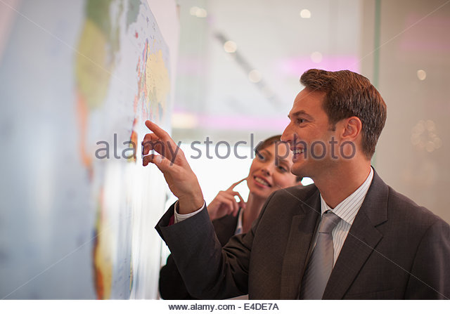 Businessman looking at world map - Stock Image