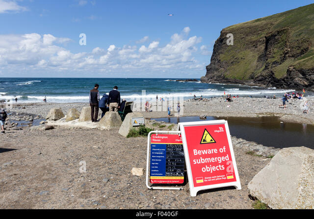 Warning and information Signs on the Beach at Crackington Haven Cornwall UK - Stock Image