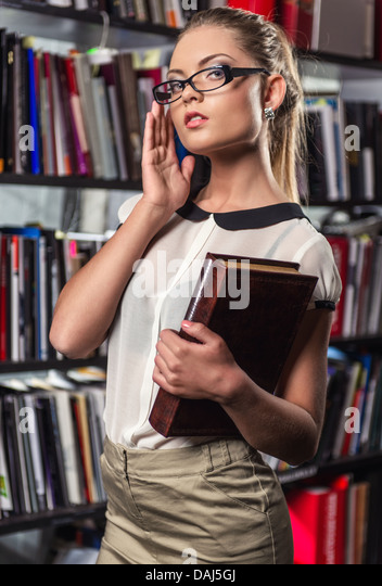Student at the library - Stock Image
