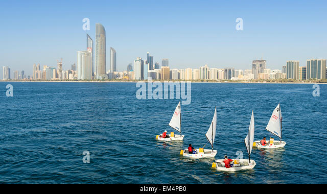 Daytime skyline view and sailing boats in Abu Dhabi in United Arab Emirates - Stock Image