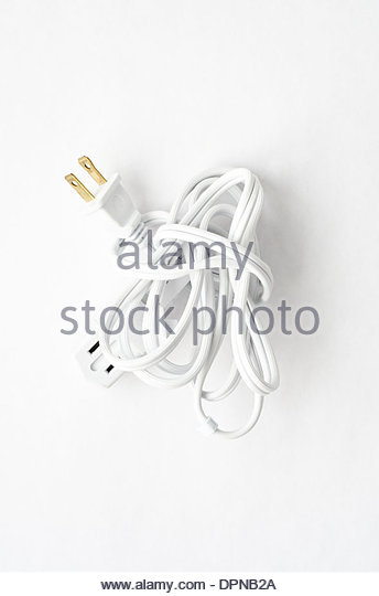 Bundle of white extension cord tied in a knot on white background - Stock Image