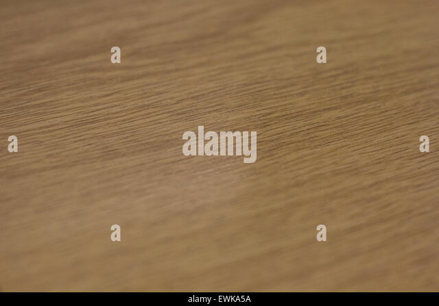 Selected focus on a varnished wooden table top - Stock Image