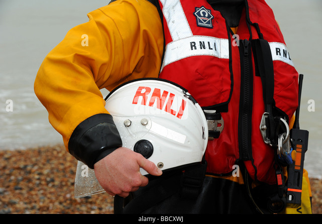 A member of the rnli on the beach - Stock Image