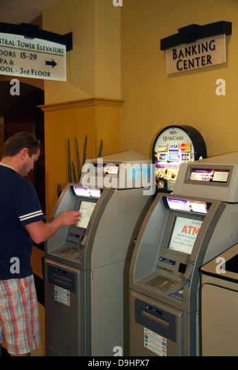 Nevada Las Vegas Las Vegas Hotel & Casino LVH lobby man using self service ATM banking - Stock Image