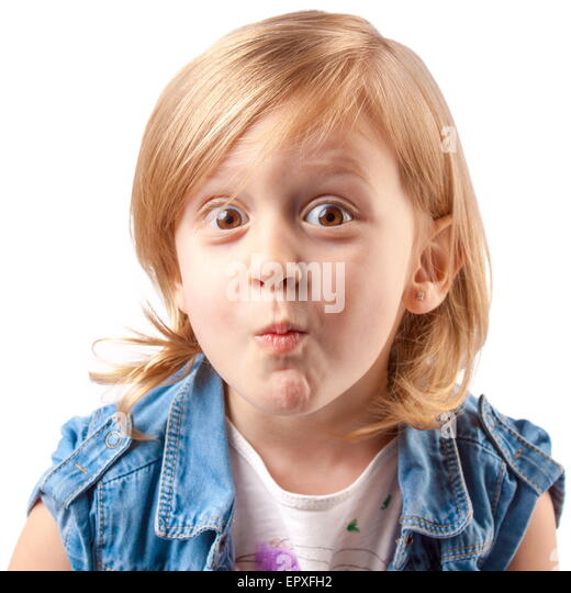 Little cute girl making grimace and having fun - Stock Image