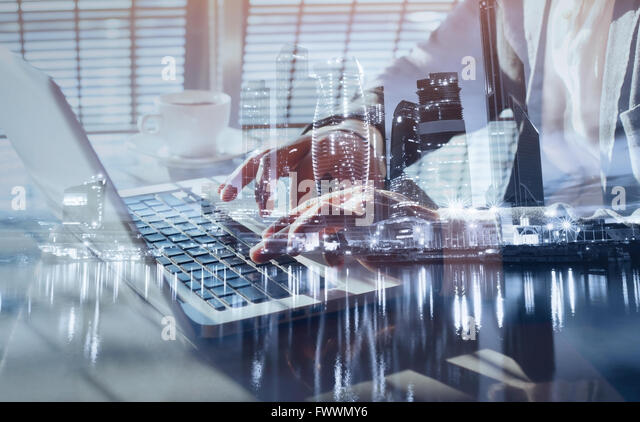 working on laptop, close up of hands of business man, double exposure - Stock-Bilder