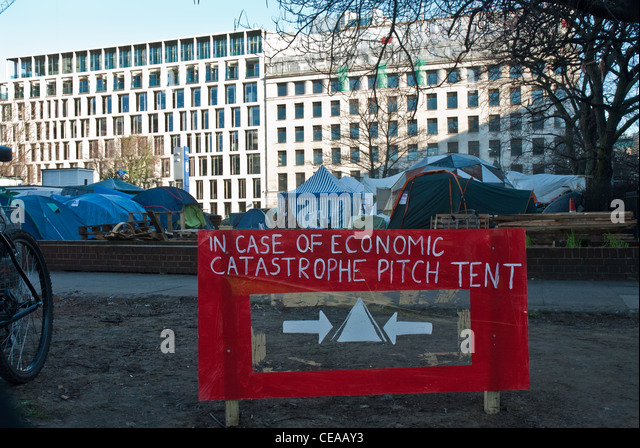 Placard in front of tents of Occupy London, Finsbury Square site  and city offices 'In case of economic catastrophe - Stock Image
