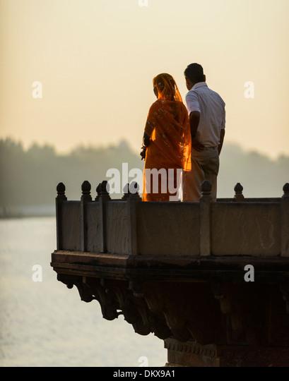 Mathura, Indian couple watching sunrise on Holi. - Stock-Bilder