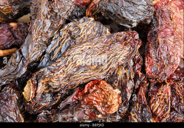 Chipotles. Dried, smoked jalapeno chillies used to add a smoky heat to Mexican and TexMex dishes. - Stock-Bilder