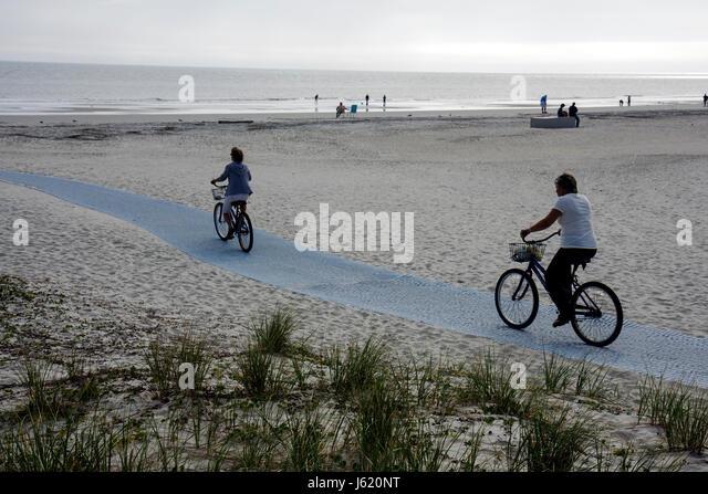 South Carolina Hilton Head Island South Forest Beach Atlantic Ocean resort dune grass woman bicycle cyclist cycle - Stock Image