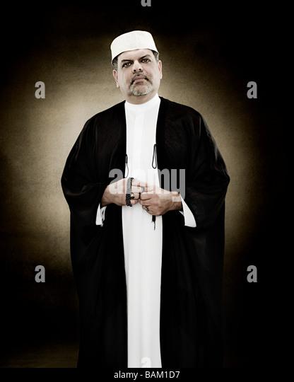 Portrait of a muslim man holding prayer beads - Stock Image