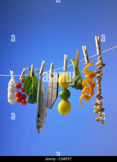 Healthy foods pegged to a washing line - Stock Image