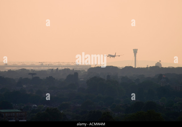 Commercial aeroplane coming to land at London Heathrow Airport view from Richmond Park - Stock Image