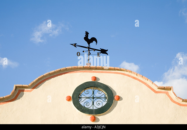 Weather vane on a building - Stock Image