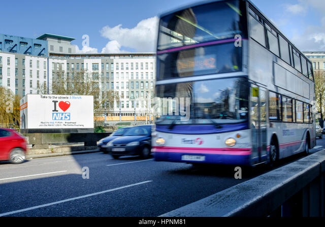 A large billboard sign advertising a save our NHS protest march and demonstration rally in Bristol is pictured next - Stock Image