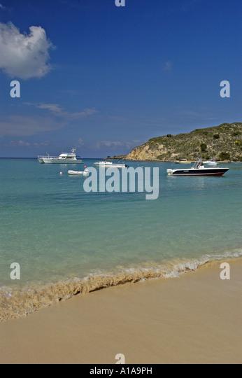 Anguilla beach at Sandy Ground boats water shoreline - Stock Image