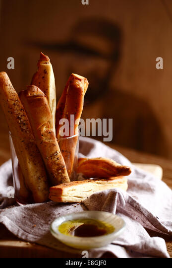 Breadsticks with olive oil and balsamic vinegar - Stock-Bilder