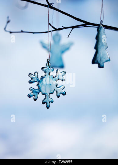 Handmade christmas decoration made from blue glass - Stock Image