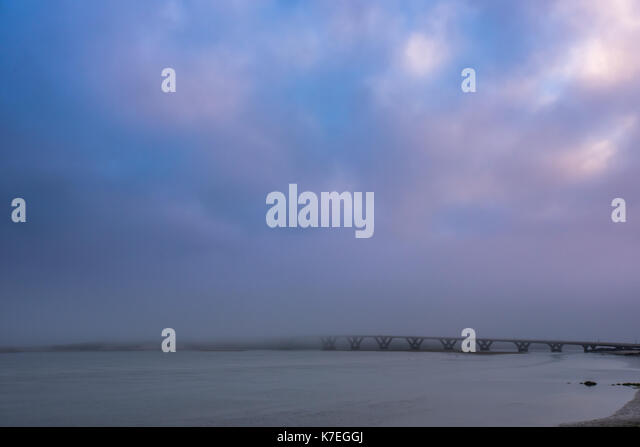 Alsea Bay Bridge Disappears into the Fog in early morning - Stock Image