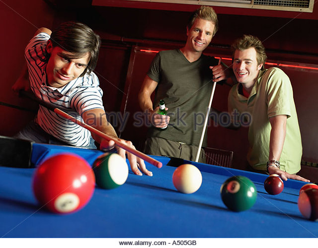 Men playing pool - Stock Image