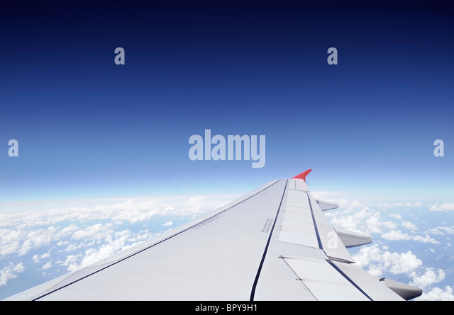 Airplane Wing in Flight - Stock Image