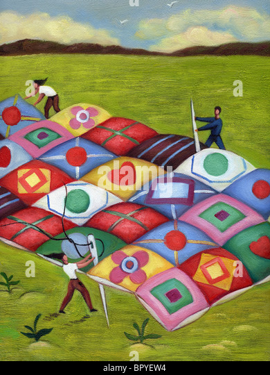 People sewing a large quilt together - Stock Image