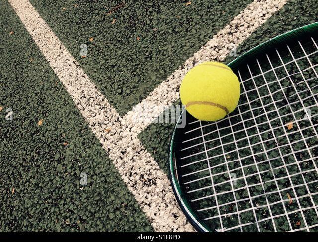 Tennis racket and ball on tennis court - Stock-Bilder