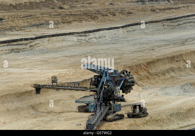 Coal mining in an open pit with huge industrial machine - Stock-Bilder