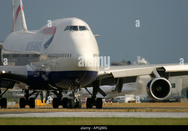Boeing 747 436 of British Airways taxiing for departure at London Heathrow Airport - Stock Image