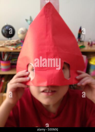 Child red mask - Stock Image