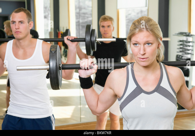Three lifting weights - Stock Image