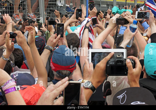 Crowd of people all with cameras,phones & tablets at an event - Stock Image