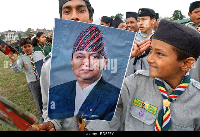 Children hold posters of King Gyanendra and Queen Komal as thousands of people arrive to celebrate Democracy Day - Stock Image