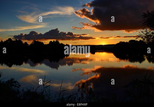 Sunset over river - Stock-Bilder