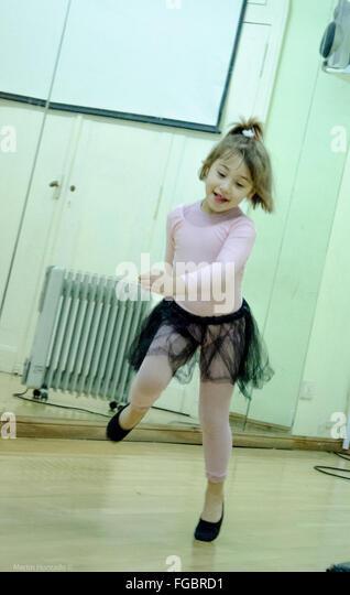 Cute Ballet Dancer Running In Dance Studio - Stock Image