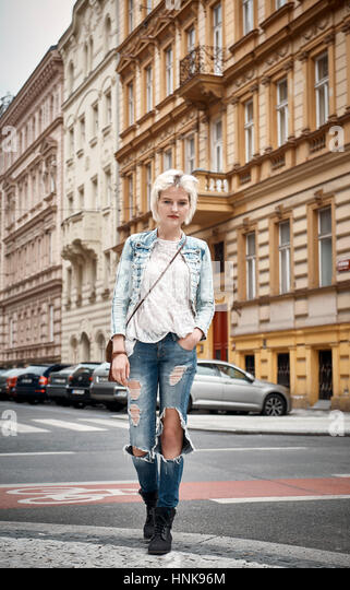 Street portrait of young woman in Prague, Czech Republic - Stock Image