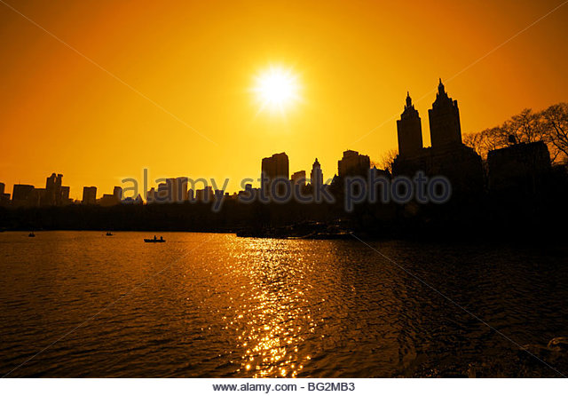 sunset over the lake in central park - Stock Image