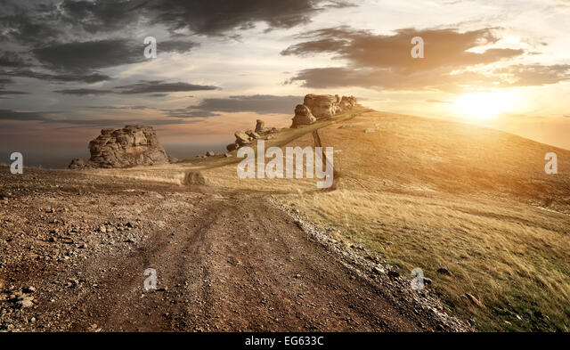 Evening over country road in high mountains - Stock Image
