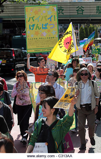 Greenpeace activists join a march of 5,000 people in Shibuya, calling on the Japanese government to abandon nuclear - Stock Image