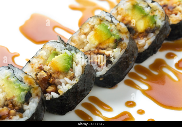 A Japanese sushi dish on a dish and adorned with sweet sauce. - Stock Image