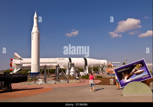 Rocket garden outdoor attraction with tourists Kennedy Space Center Visitor Center, Florida - Stock Image
