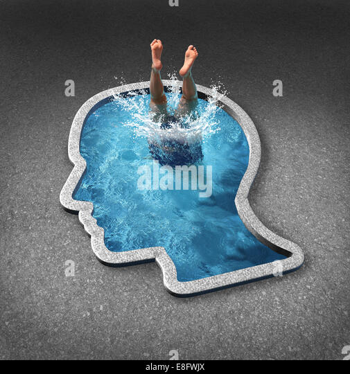 Deep thinking and soul searching concept with a person diving into a swimming pool shaped as a human face as a symbol - Stock-Bilder