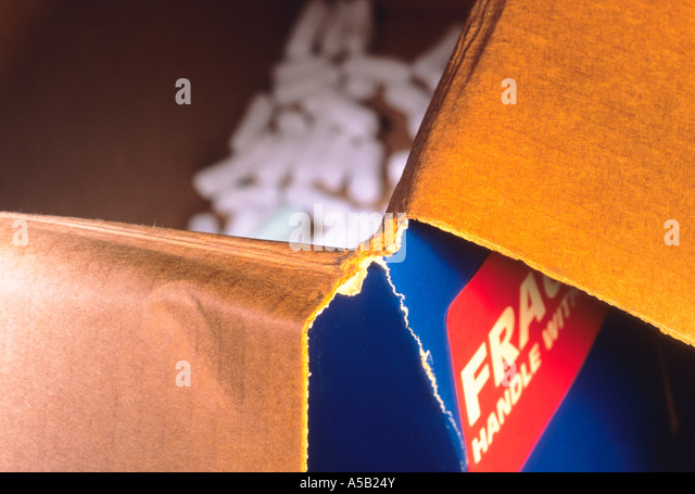 Empty Cardboard Box Packing Carton Box With Peanuts - Stock Image
