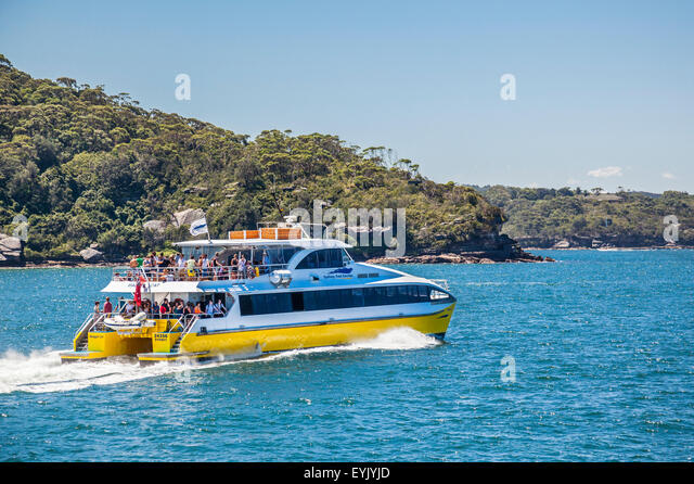 Australia, New South Wales, Sydney Harbour, Port Jackson, Sydney Fast Ferry passes Georges Head - Stock Image