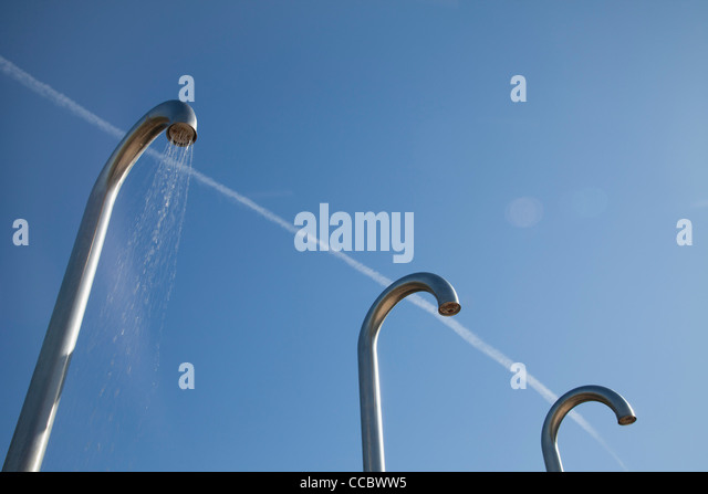 Outdoor public showers - Stock Image