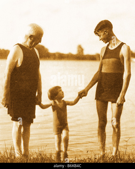 retro photo of three generations made circa 1920 by lake - Stock Image