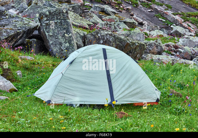 Lightweight hiking dome tent on the green grass - Stock Image