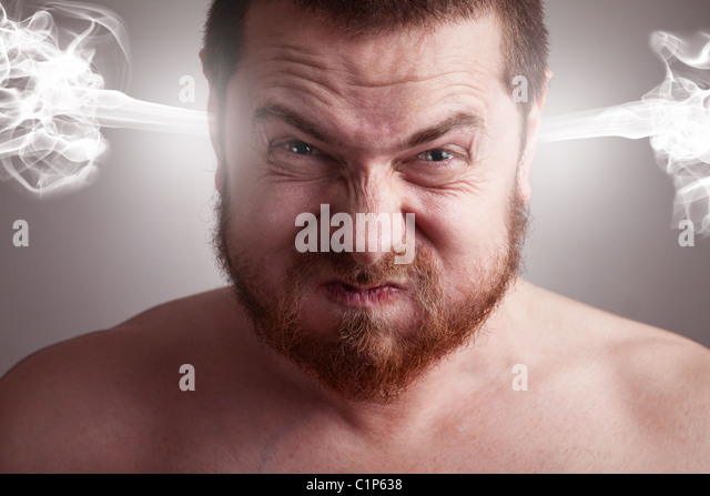 Stress concept - angry frustrated man with exploding head - Stock Image