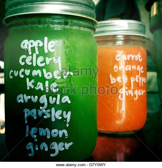 Jar of fresh juice with list of ingredients - Stock Image
