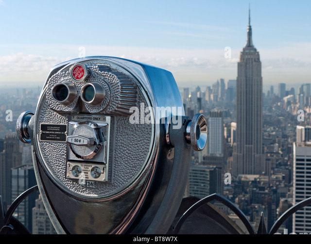 Public pay viewing coin operated binoculars on Top of The Rock observation platform at Rockefeller Center in Manhattan - Stock Image